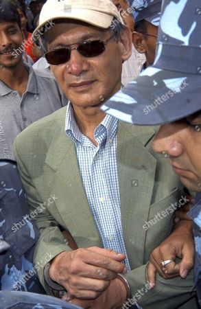 """Charles Sobhraj Police escort convicted French serial killer Charles Sobhraj from court in Katmandu, Nepal. Nepal's Supreme Court on July 30, 2010, upheld the conviction of Sobhraj nicknamed """"The Serpent"""" who was convicted of slaying an American tourist in Katmandu more than three decades ago. Sobhraj would serve his life sentence in a Nepali jail"""