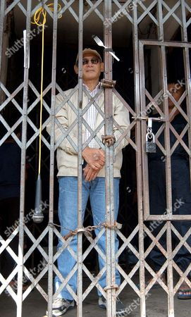 CHARLES SOBHRAJ Confessed serial killer Charles Sobhraj, 59, stands in a police station before being taken to the court in Katmandu, Nepal, . Prosecuters charged Sobhraj with murdering two western backpackers in 1975 at a court in Katmandu on Monday