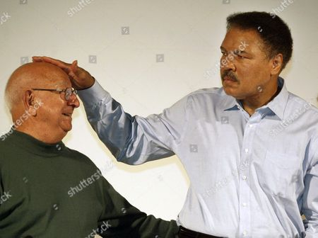 Angelo Dundee Boxing great Muhammad Ali touches the head of his former coach Angelo Dundee at the Book Fair in Frankfurt, Germany. Dundee, the trainer who helped groom Ali and Sugar Ray Leonard into world champions and became one of boxing's most recognizable figures, died . He was 90
