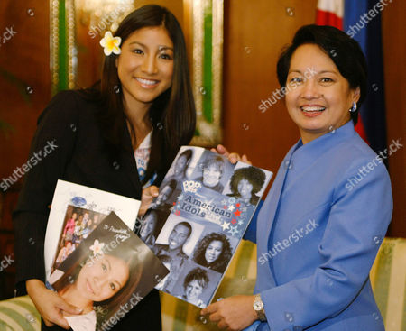 "TRIAS ARROYO Popular teen celebrity Jasmine Trias of the widely viewed television talent show ""American Idol,"" shows to Philippine President Gloria Macapagal Arroyo her photos and that of fellow finalists during her courtesy call at Malacanang Palace in Manila on . Trias, born to Filipino parents and raised in Hawaii, came to the Philippines for the first time for a big concert"