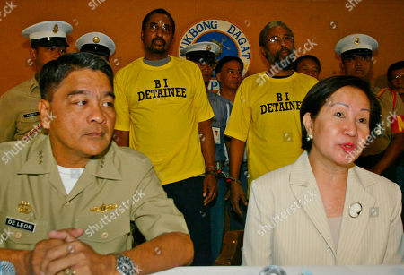LEON Philippine Immigration Chief Andrea Domingo, seated right, and Navy Chief Vice-Admiral Ernesto De Leon, seated left, present to the media, Americans James Stubbs Jr., in yellow shirt right, also known as Jamil Daud Mujahid, and his brother Michael Ray Stubbs, both from Missouri, . Authorities were set to deport two American brothers who were arrested for suspected links to terrorism, immigration officials said Tuesday