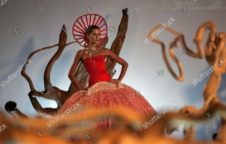 Portuguese model Sofia Aparicio displays a creation, part of the Story Tailors fashion show, during the Lisboa Fashion Week in Lisbon, Portugal