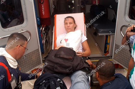 Carla Diaz is taking inside the ambulance after the plane she was traveling crashed during the landing at Luis Munoz Marin International Airport in San Juan, Puerto Rico on . An American Eagle flight tipped and crashed during landing Sunday when one of its tires blew out upon touching down at San Juan's main airport, injuring at least 11 people on board
