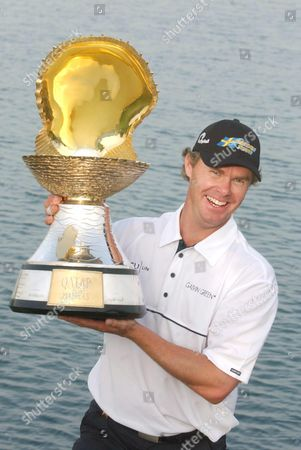 Qatar Masters champion Joakim Haeggman, of Sweden, poses with the Pearl trophy, at the Doha Golf Club in Doha, Qatar. Haeggman scored an aggregate of 16-under-par 272 for a one stroke victory