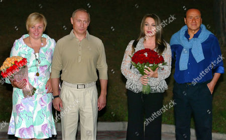 Lyudmila Putina, Vladimir Putin, Veronica Lario, Silvio Berlusconi Taken, from left: then wife of Russian President Lyudmila Putina, Russian President Vladimir Putin, wife of Italian Prime Minister Silvio Berlusconi's ex-wife Veronica Lario, and Italian Prime Minister Silvio Berlusconi pose for photographers during the meeting in Putin's residence in the Russian Black Sea resort of Sochi. Russian President Vladimir Putin and his wife Lyudmila said Thursday, June 6, 2013, they are divorcing after nearly 30 years of marriage, making the announcement on state television after attending a ballet performance at the Kremlin