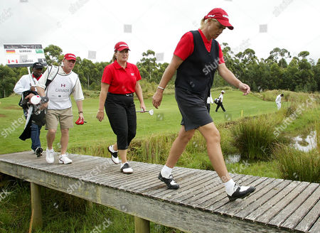GOLF Canada's Lorie Kane, back, and Dawn Coe-Jones, front, study a course on the first day of a Women's World Cup Of Golf at The Links at Fancourt Country Club, South Africa, . Canada shot 7-under 66 in the better-ball format and shared the lead with Italy after the first round of the Women's World Cup
