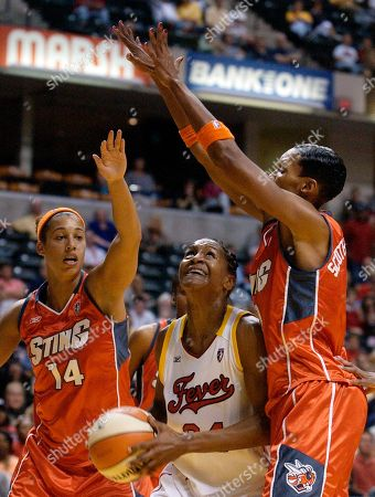CATCHINGS POWELL RICHARDSON Indiana Fever forward Tamika Catchings, center, puts up a shot against Charlotte Sting guard Nicole Powell, left, and center Olympia Scott-Richardson during the second half in Indianapolis,. The Sting won, 63-53