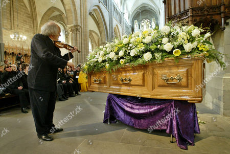 Violonist Ivry Gitlis, ambassador to the UNESCO, plays in front of the coffin of late actor and writer Sir Peter Ustinov during the funeral service at St Pierre's Cathedral in Geneva, Switzerland, . Sir Peter died on Sunday aged 82