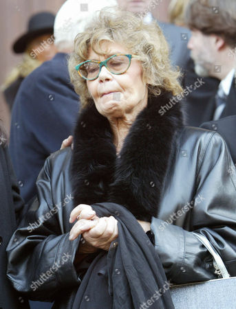 Helene du Lau, widow of the late Sir Peter Ustinov, reacts as she follows the coffin of the actor, writer and raconteur, after the funeral ceremony at the Cathedral of St. Pierre in Geneva, Switzerland, . Sir Peter died on Sunday, March 28, 2004, at the age of 82