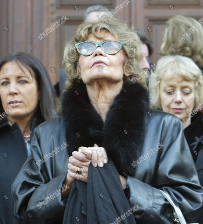 Helene du Lau, widow of late Sir Peter Ustinov, looks up as she follows the coffin of late actor, writer and raconteur Sir Peter Ustinov after the funeral ceremony at the Cathedral of St. Pierre in Geneva, Switzerland, . Sir Peter died on Sunday aged 82