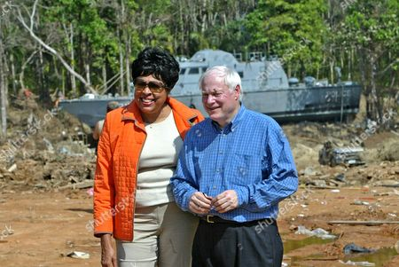 LEACH AND WATSON International Relations Asia subcommittee Chairman Rep. Jim Leach, R-Iowa, right, with Rep. Diane Watson, D-Calif., pose for photos at the site of the tsunami devastation in Khao Lak in southern Thailand on . U.S. officials are providing an initial $35 million aid package and have pledged to provide more help