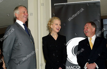 """ALLEN KIDMAN DAUTH Australian actress Nicole Kidman, center, enjoys a conversation with Australian Ambassador to United Nations John Dauth, right, and Australian Consul General Ken Allen at a celebration for her upcoming movie """"The Interpreter"""" which was filmed on location at UN headquarters in New York, Monday, April, 26, 2004"""