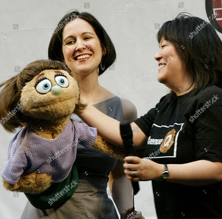 "Avenue Q"" stars Stephanie D'Abruzzo, center, and Ann Harada, right, perform with Kate Monster during ""Stars in the Alley,"" a free concert by Broadway stars in New York's theater district, . The show marks the end of the 2003-2004 theater season. D'Abruzzo, is nominated for a Tony Award for best actress in a musical, while the show is nominated for best musical. The award show is this Sunday, June 6"