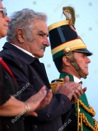 URUGUAY Jos Mujica, left, ex-guerrilla fighter from the Tupamaros movement in the 1960s, and today's most voted senator in the Uruguayan Parliament, watches the military parade at the installation ceremony of the newly elected Parliament in Montevideo, Uruguay, Tuesday, 15, 2005. For the first time in Uruguayan history there is a majority of left wing members in an elected Parliament