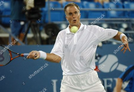 MARTIN Todd Martin from the United States returns the ball to Fabrice Santoro from France at the U.S. Open tennis tournament in New York; Monday Aug. 30; 2004
