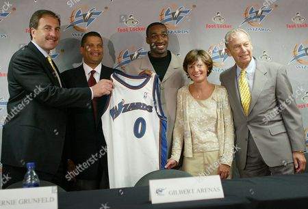 O'MALLEY New Washington Wizards guard Gilbert Arenas, center, poses with his jersey along with, from left, Ernie Grunfeld, president of basketball operations, coach Eddie Jordan, Susan O'Malley, president of Washington Sports and Entertainment, and owner Abe Pollin at a news conference in Washington