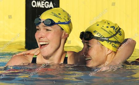 ROONEY EDINGTON Australia's Giaan Rooney, left, celebrates with teammate Sophie Edington after winning the gold medal in the women's 50-meter backstroke at the World Aquatics Championships in Montreal