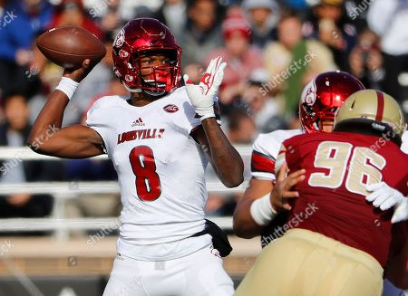 Lamar Jackson, Ray Smith Louisville quarterback Lamar Jackson throws over Boston College defensive tackle Ray Smith (96) during the first half of an NCAA football game at Alumni Stadium in Boston