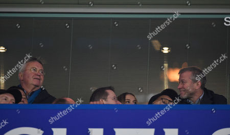 Chelsea owner Roman Abramovich glances over to former Chelsea manager Guus Hiddink during the Premier League match between Chelsea and Everton played at Stamford Bridge London on 5th November 2016