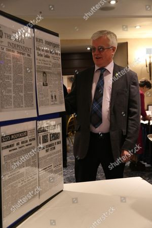 Ian Hudghton MEP and President of the Scottish National Party (SNP), looks at a display of back issues of the Scots Independent newspaper