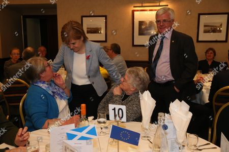 Ian Hudghton MEP and President of the Scottish National Party (SNP) watches Nicola Sturgeon MSP, First Minister of Scotland and Leader of the Scottish National Party (SNP), talk with Flora MacCormick and Rena Moore