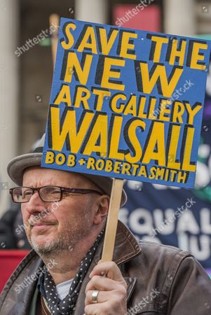 Artist Bob and Roberta Smith joins the protest and addresses the crowd - Llibrary campaigners, arts and culture lovers and museum and gallery workers stage a national demonstration, supported by PCS and Unite, in London against cuts to our sector. The march went from the British Library to trafalgar Square, where there were speeches.