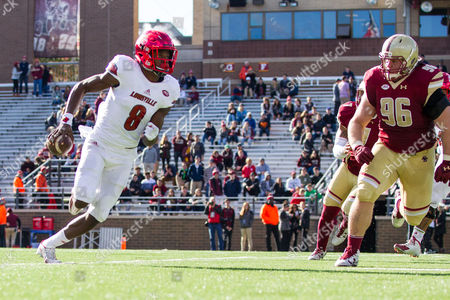 , 2016; Chestnut Hill, MA, USA; Louisville Cardinals quarterback Lamar Jackson (8) pursued by Boston College Eagles defensive tackle Ray Smith (96) during the second half of an NCAA football game between the Boston College Eagles and Louisville Cardinals at Alumni Stadium. Louisville defeated Boston College 52-7