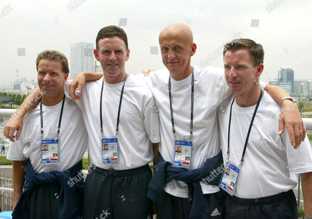 Italian referee Pierluigi Collina, second from right, who will take charge of the 2002 World Cup soccer final between Brazil and Germany in Yokohama, is seen with his assistants for the final in Yokohama, Japan, Friday, June 28, 2002. From left to right are Lief Lindberg, Sweden: Hugh Dallas, Scotland, who will be the fourth offficial, Collina and Philip Sharp, England