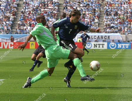 Nigeria defender Taribo West, left, battles with Argentina forward Claudio Lopez during their 2002 World Cup match in Ibaraki, Japan. Nigeria and Argentina play in Group F along with Sweden and England