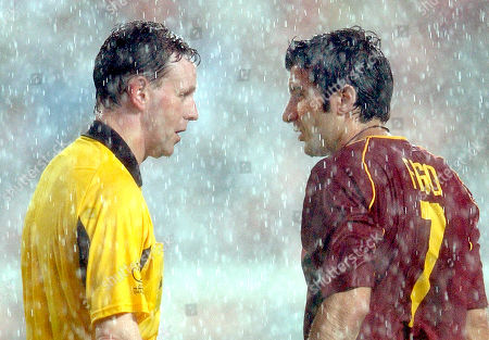 DALLAS FIGO Referee Hugh Dallas of Scotland, left, and Portugal's striker Luis Figo chat under heavy rain during the 2002 World Cup Group D soccer match between Poland and Portugal at the Jeonju World Cup stadium in Jeonju, South Korea, . The other teams in Group D are South Korea and the United States