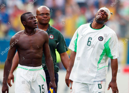Nigeria defender Taribo West, right, and teammate Justice Christopher, left, leave the field after being eliminated from the 2002 World Cup after losing to Sweden in Kobe, Japan . Sweden and Nigeria play in Group F along with England and Argentina
