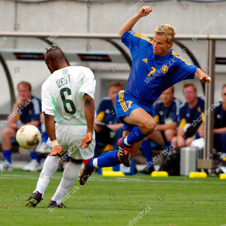 Sweden midfielder Niclas Alexandersson, right, kicks the ball away from Nigeria defender Taribo West during their 2002 World Cup match in Kobe, Japan . Sweden and Nigeria play in Group F along with England and Argentina