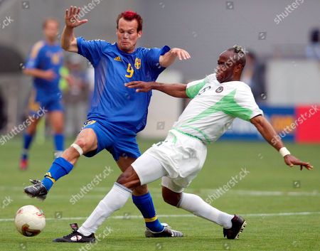Sweden midfielder Fredrik Ljungberg, left, battles Nigeria defender Taribo West during their 2002 World Cup match in Kobe, Japan . Sweden and Nigeria play in Group F along with England and Argentina