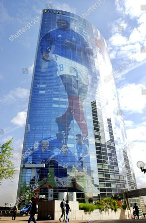 HENRY A giant poster showing the captain of the French soccer team Marcel Desailly, top, along with teammates, defender Franck Leboeuf, strikers Sylvain Wiltord, David Trezeguet and Thierry Henry, from left, covers the Cegetel headquarters building in La Defense, outside Paris, . The 100 meters high and 62 meters wide poster covers some 1, 500 windows and a total area of 3, 330 square meters, being one of the largest of its kind in Europe. France inaugurates the World Cup Friday in Seoul, Korea, against Senegal. Vivendi Universal's cell phone unit Cegetel and mobile operator SFR sponsored the operation