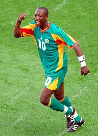 FADIGA Senegal's Khalilou Fadiga reacts after he scored on a penalty kick against Uruguay during their 2002 World Cup Group A soccer match at the Suwon World Cup stadium in Suwon, South Korea, . The other teams in Group A are France and Denmark