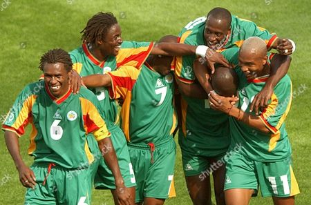 Senegal's players celebrate after scoring their third goal in the first half of their 2002 World Cup Group A soccer match against Uruguay at the Suwon World Cup stadium in Suwon, South Korea, . From left are Aliou Cisse, Alassane Ndour, Henri Camara, Khalilou Fadiga, Papa Bouba Diop (hidden) and El Hadji Diouf. The other teams in Group A are France and Denmark