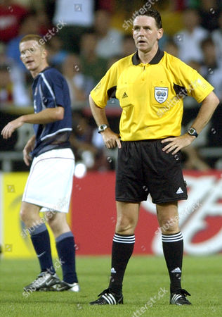O'BRIEN DALLAS USA's John O'Brien, background, walks past Scottish referee Hugh Dallas, during the 2002 World Cup quarterfinal soccer match between Germany and USA, at the Munsu Football stadium in Ulsan, South Korea
