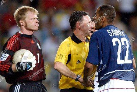 SANNEH KHAN DALLAS USA's Tony Sanneh, right, faces referee Hugh Dallas of Scotland and Germany goalkeeper Oliver Kahn, during the 2002 World Cup quarterfinal soccer match between Germany and USA, at the Munsu Football stadium in Ulsan, South Korea