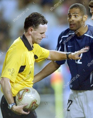 Stock Image of SANNEH DALLAS USA's Tony Sanneh, right, faces referee Hugh Dallas of Scotland, during the 2002 World Cup quarterfinal soccer match between Germany and USA, at the Munsu Football stadium in Ulsan, South Korea