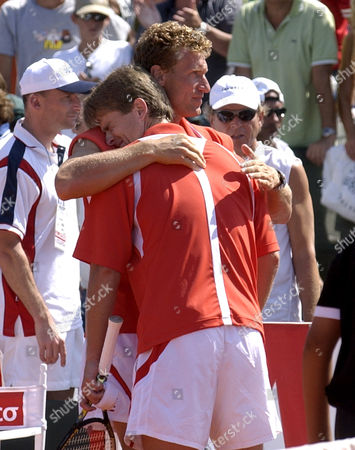 KOLHLMANN Germany Michael Kohlmann is comforted by team captain Patrick Kuehnen after losing against Argentines David Nalbandian and Lucas Anold 6-1, 0-6, 4-6, 6-1, 6-2, in their doubles game to give Argentina its third straight point to win their Davis Cup match at River Plate Stadium in Buenos Aires, Argentina