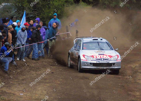 BURNS England's Richard Burns drives his Peugeot 206 accompanied by co-driver Robert Reid, in Cordoba, some 800 kilometers (500 miles) nortwest of Buenos Aires, during the second full day of the Argentine rally