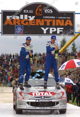 BURNS REID World champion Richard Burns of England, right, and co-driver Robert Reid spray champagne after winning the Argentina Rally in Cordoba, . Burns won the rally after Finland's Marcus Gronholm, who finished with the fastest time, was disqualified for receiving illegal help from his team