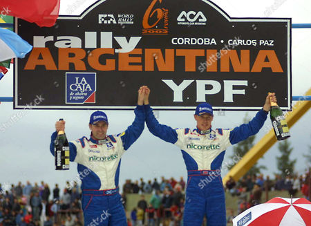 BURNS REID World champion Richard Burns of England, right, and co-driver Robert Reid wave from the podium after winning the Argentina Rally in Cordoba, Argentina, . Burns won the rally after Finland's Marcus Gronholm, who finished with the fastest time, was disqualified for receiving illegal help from his team