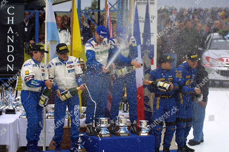 BURNS SAINZ SOLBERG World champion Richard Burns of England, center right, and co-driver Robert Reid spray champagne after winning the Argentina Rally in Cordoba, . Burns won the rally after Finland's Marcus Gronholm, who finished with the fastest time, was disqualified for receiving illegal help from his team. Spain's Carlos Sainz, second from left, and co-driver Luis Moya, left, who ended second, at right . Norway's Petter Solberg with co-driver Philip Mills who ended third