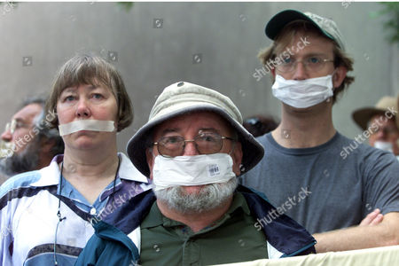 KENEALLY World renowned Australian author Thomas Keneally, center, has his mouth taped over as he takes part in a silent peaceful vigil outside the Department of Immigration in Sydney, Australia, to protest the Australian government's stance towards asylum seekers