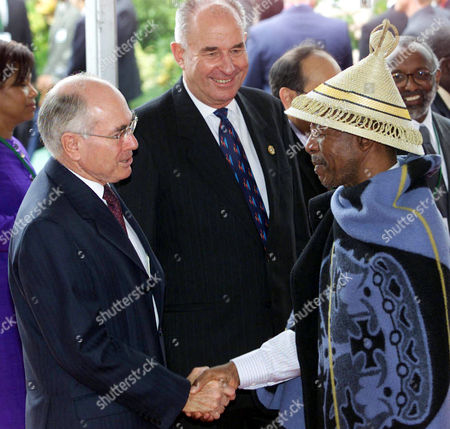 HOWARD MCKINNON MOSISILI Australian Prime Minister John Howard, left, and Commonwealth Secretary General Don McKinnon welcome the Prime Minister of Lesotho Pakalitha Mosisili, right, to the opening ceremony at The Commonwealth Heads of Government Meeting (CHOGM) at Coolum on the Sunshine Coast of Queensland, Australia