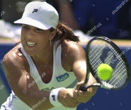 CAPRIATI American Jennifer Capriati reaches for a backhand to fellow American Alexandra Stevenson at the Sydney International tennis tournament in Sydney, . Stevenson won 7-6, 3-6, 6-4