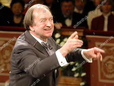 FILE In this Jan. 1, 2003 file picture Nikolaus Harnoncourt conducts the Vienna Philharmonic Orchestra during the traditional New Year's concert at the Musikverein in Vienna, Austria. Conductor Nikolaus Harnoncourt is dead after a career characterized by a search for authenticity in Baroque and other classical music. His death at 87 Saturday night was confirmed by the Gesellschaft der Musikfreunde in Wien (Society of Friends of Music in Vienna,) which was closely associated with Harnoncourt