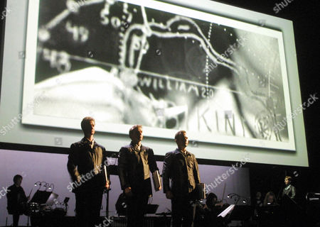 """THREE TALES Singers of the Synergy Vocals and the Orchestra Ensemble Modern perform in front of a video wall,, during the general rehearsal for the world premiere of """"Three Tales"""" from U.S. composer Steve Reich and international known video artist Beryl Korot at the Museumsquartier in Vienna. """"Three Tales"""" recalls three crucial events of the 20th century like Hindenburg, Bikini atoll and Dolly the cloned sheep. The performance is focused on the physical, ethical and religious significance of the rapid technological development. The world premiere on Sunday, May 12 is part of the Vienna Festival 2002"""