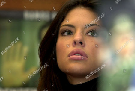 CAMASSA Miss Italy World Pamela Camassa listens to comments during a report on the death penalty worldwide at the European Parliament, in Brussels, Belgium. Miss World participants present at the 2002 report launch will appeal against boycotting the beauty contest, which Abuja, Nigeria is due to host in December, and encourage mass participation to spotlight Amina Lawal's plight to save her life against a stoning sentence